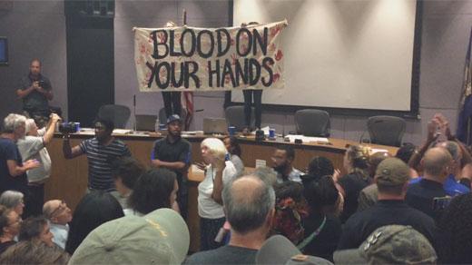 Sign displayed at city council meeting