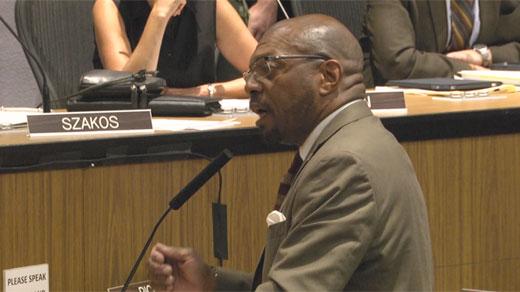 Don Gathers, speaking at the podium