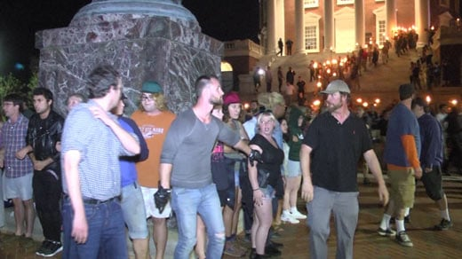 "Counterprotesters around the statue of Thomas Jefferson as ""alt-right"" supporters march around the UVA Rotunda (FILE IMAGE)"