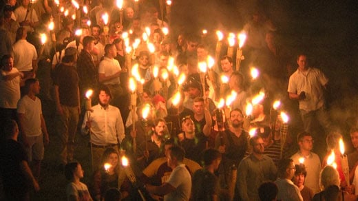 "Supporters and members of the ""alt-right"" carrying torches during a march at UVA (FILE IMAGE)"