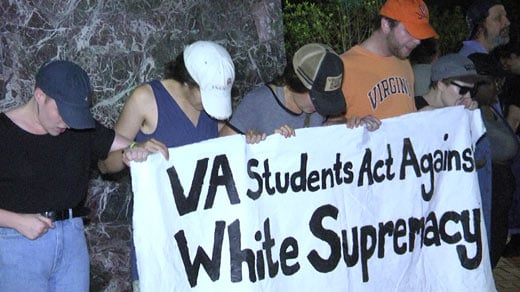 """Counterprotesters at the base of the Thomas Jefferson statue holding a sign that reads, """"VA Students Act Against White Supremacy"""" (FILE IMAGE)"""