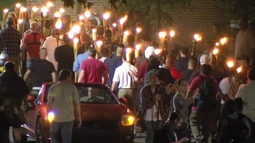 "Members of the ""alt-right"" marching with torches through UVA (FILE IMAGE)"