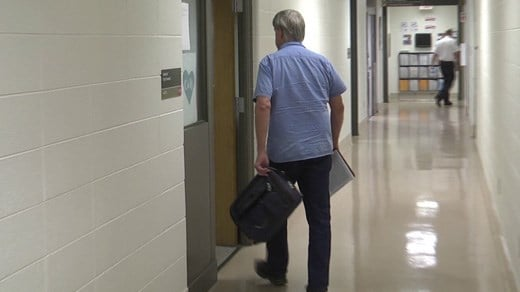 Councilor Bob Fenwick entering a closed session meeting
