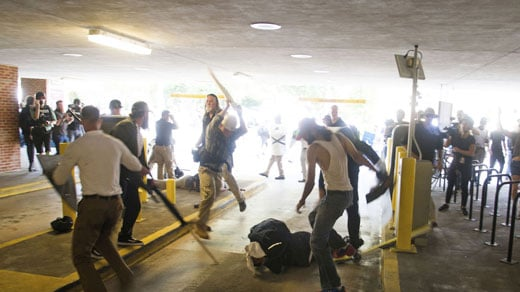Harris being attacked inside the Market Street Parking Garage (Photo courtesy Zach Roberts / AP)