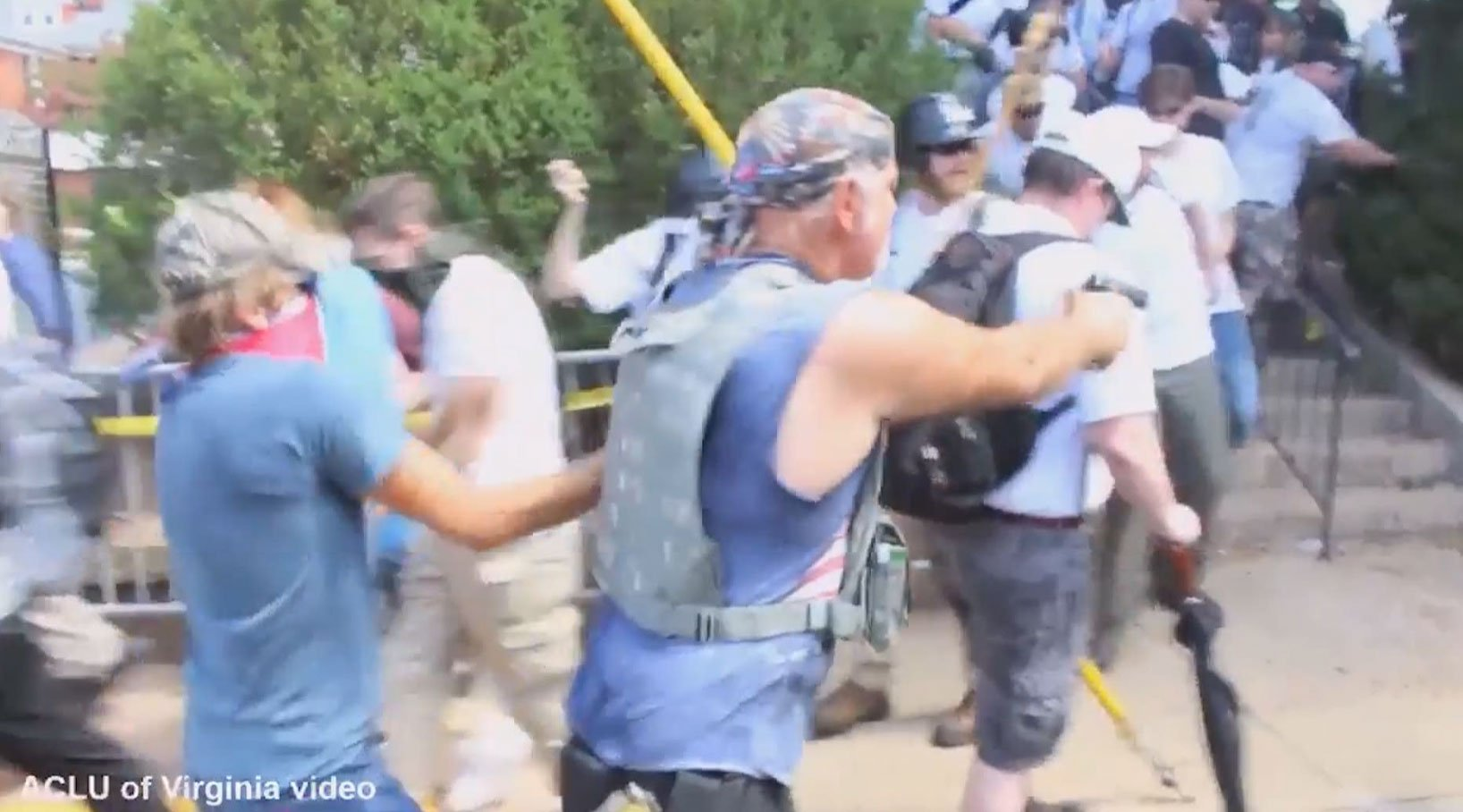 Man believed to be Richard Preston appears to be firing a gun into a crowd at the Unite the Right rally (Image Courtesy ACLU of Virginia)