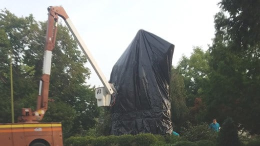 Crews again put a tarp over the Lee statue in Emancipation Park