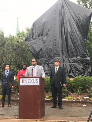 Nexus Caridades Attorneys Inc.holding a news conference in front of the Lee statue in Emancipation Park