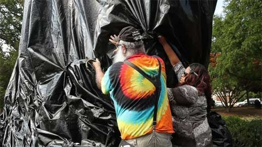 John Miska and others remove tarp covering Jefferson statue. photo courtesy of UVA activist group