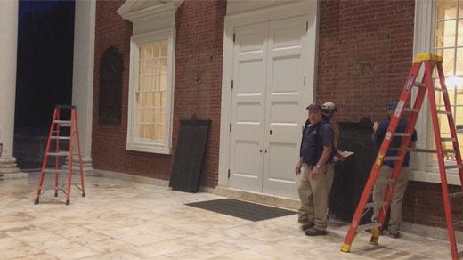 Crews removing plaques on UVA Rotunda