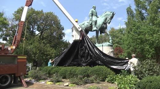 Crews again covering up the state of Robert E. Lee in Emancipation Park