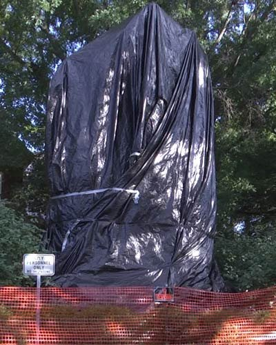 A tarp covers the Jackson stature in Justice Park (FILE IMAGE)