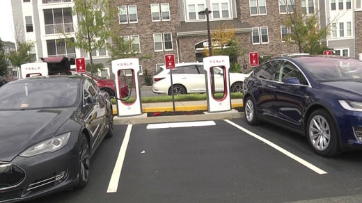 Cars charging at the Tesla station