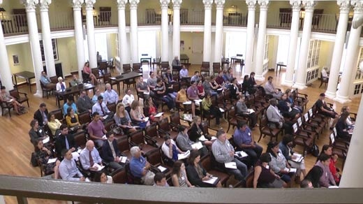 People attending a conference event inside the UVA Rotunda