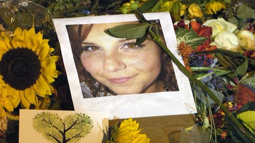 Picture of Heather Heyer among flowers at a make-shift memorial in downtown Charlottesville (FILE IMAGE)