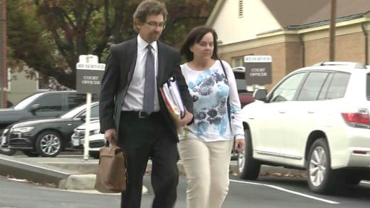 Anne Shumate Williams (aka Anne Goland) entering the courthouse in Orange County with one of her attorneys