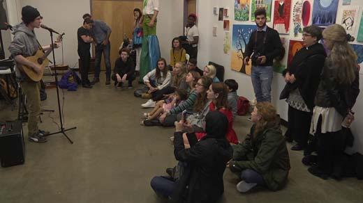 A group listens to music at IX Art Park