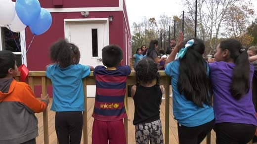 Kids celebrating at the day's ribbon-cutting
