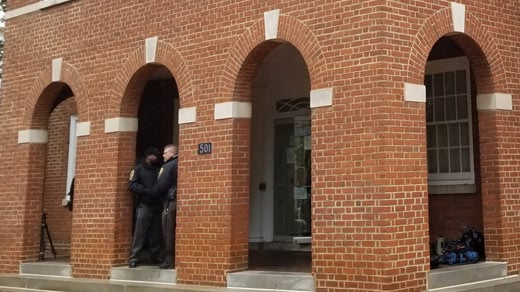 Officers standing outside Albemarle General District Court