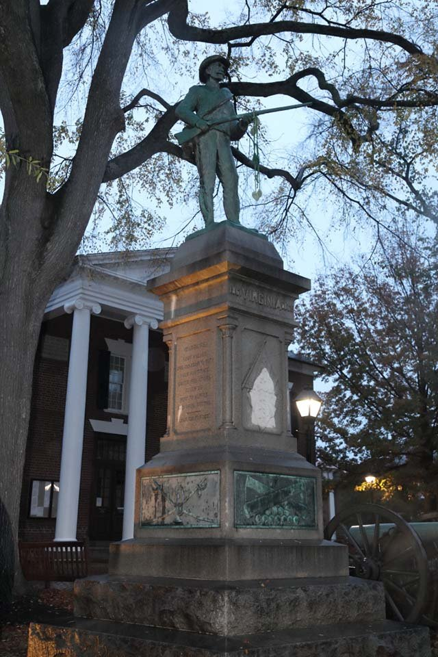 The Confederate statue after the knitted kudzu had been removed