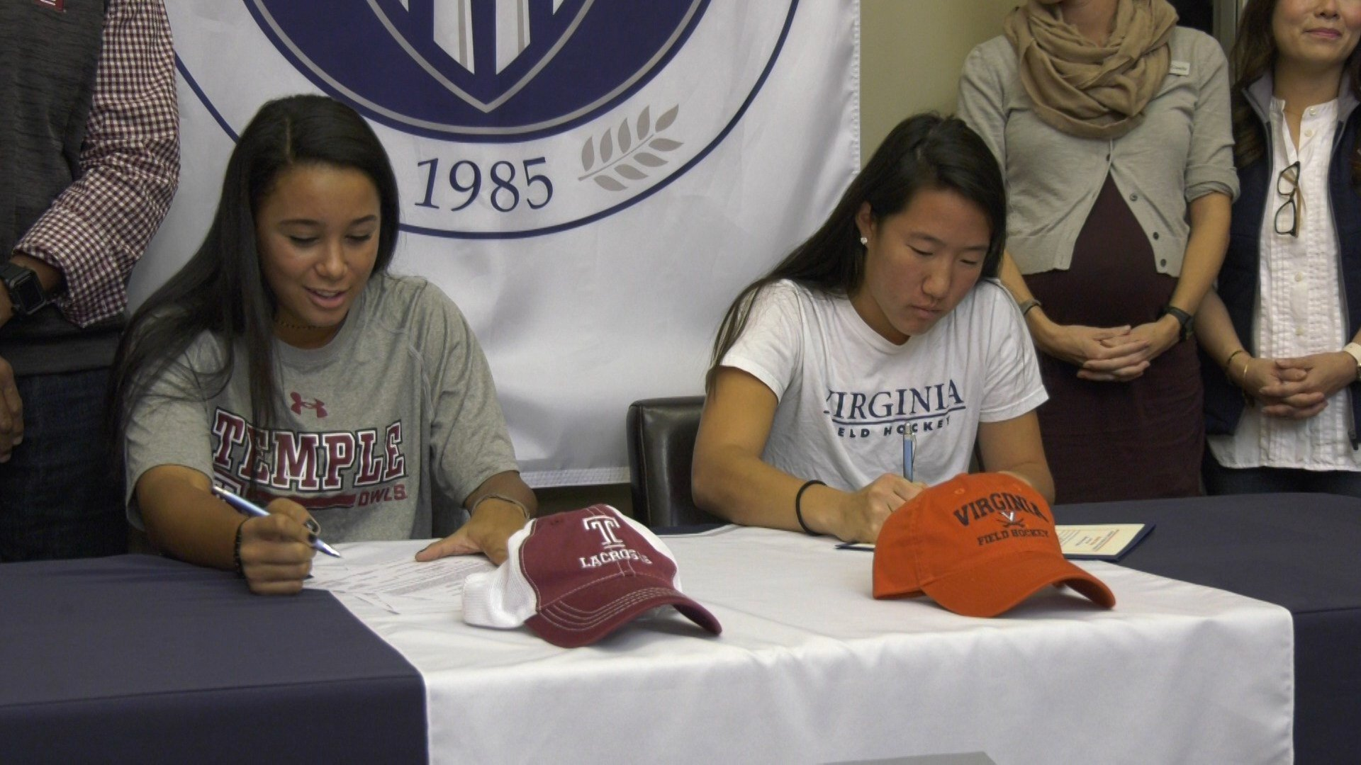 Archer signs with Temple lacrosse.   Shim signs with UVA field hockey