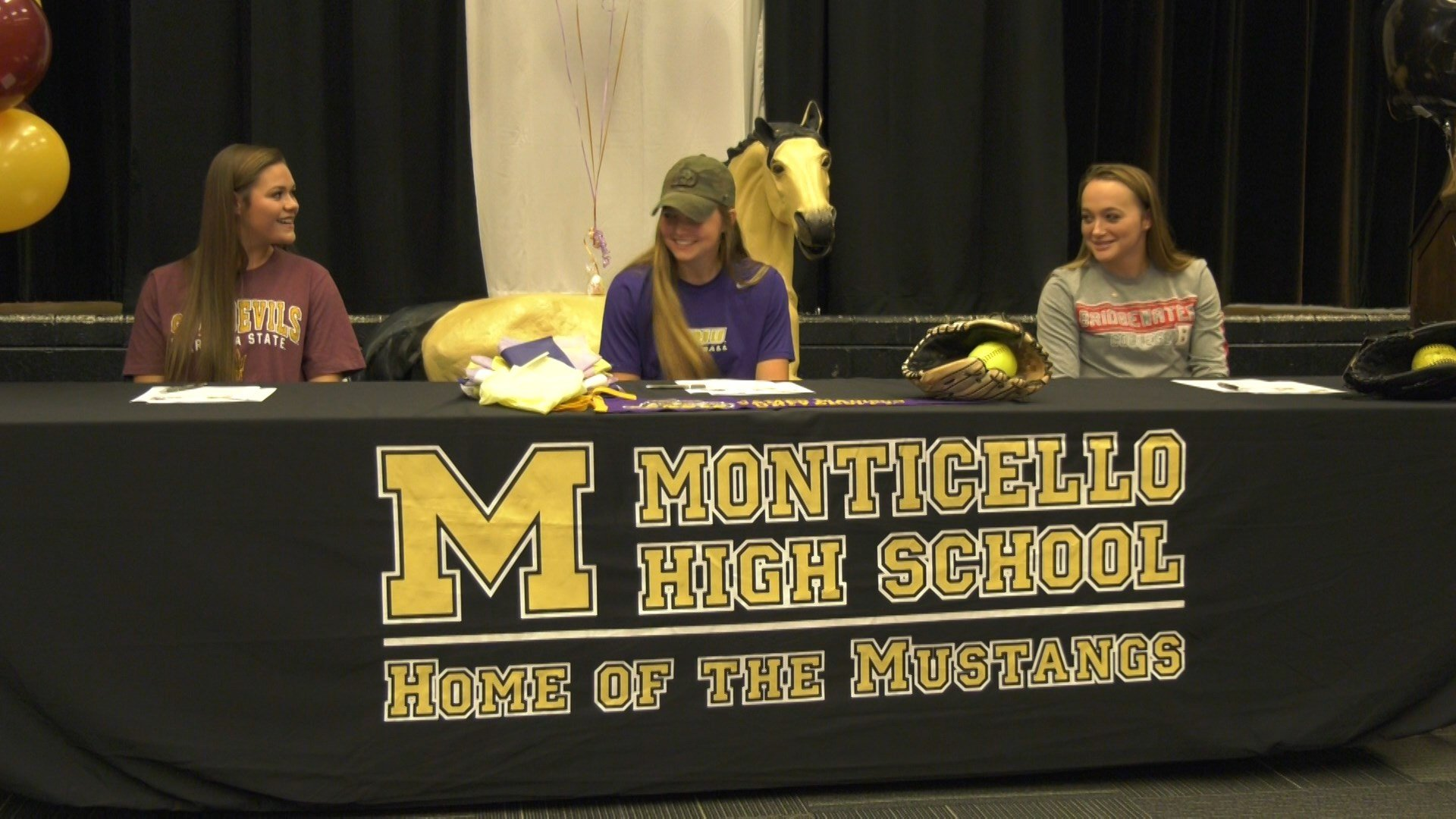 Three Mustang students signed NLI's on Thursday