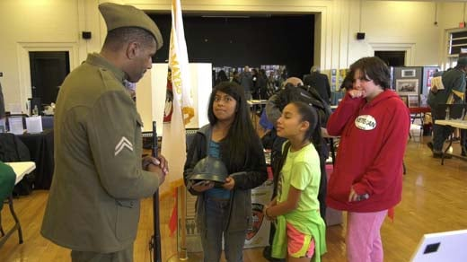A veteran speaks to kids