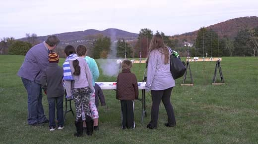 A group of kids launches a rocket
