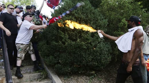 Corey Long using a flame-throwing device by Emancipation Park (Photo courtesy Associated Press)