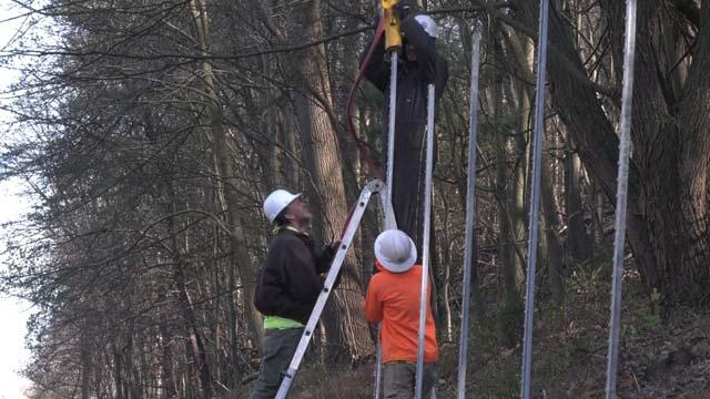 Crews installing fences along the Mechums River Bridge