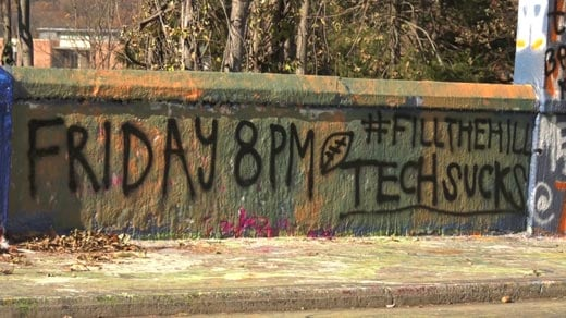 Graffiti on Beta Bridge encouraging UVA fans to go to Friday's game at Scott Stadium