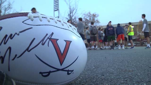 UVA fraternity brothers ran the game ball back to Charlottesville