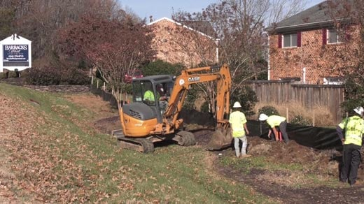 Sidewalk work outside Barracks West Apartments in Albemarle County