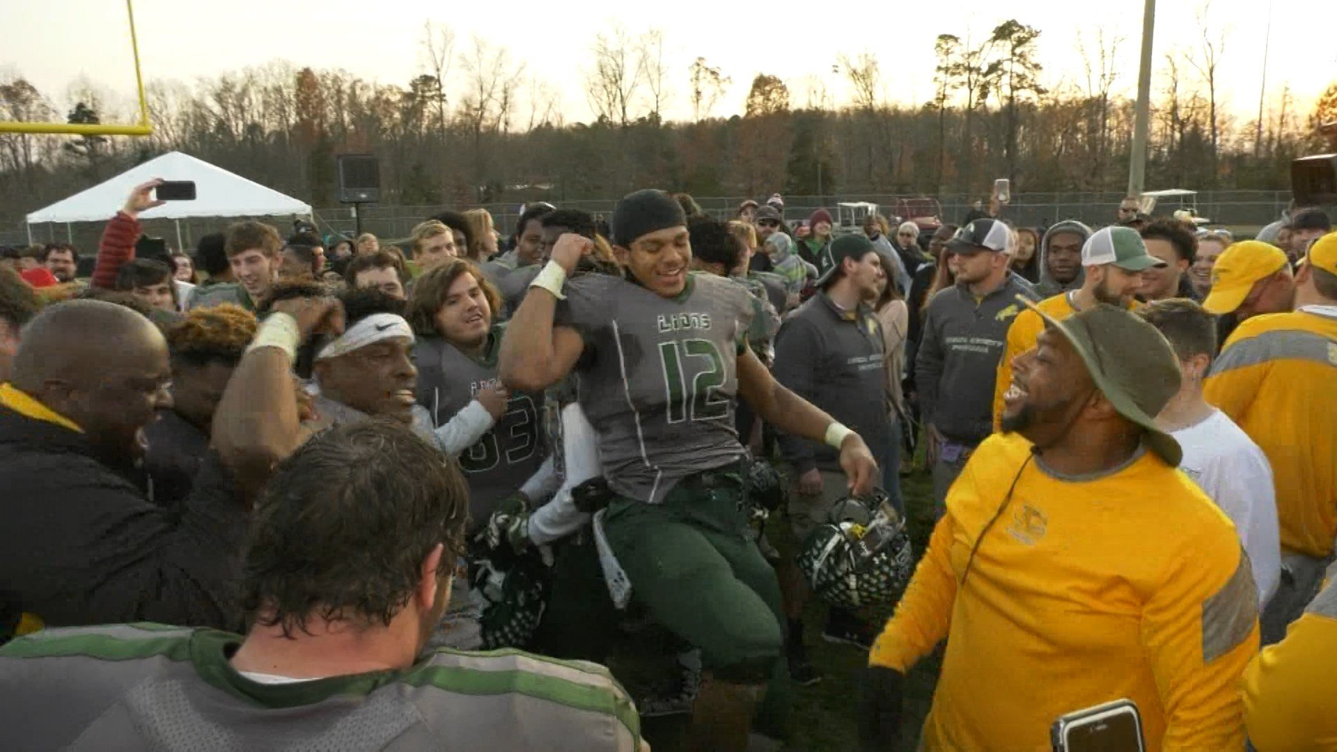 Louisa County celebrates after beating Lafayette in the state semifinals