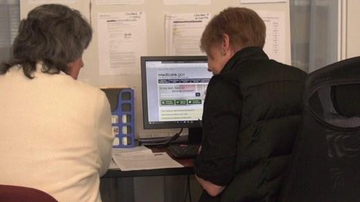 Volunteer at JABA helping a person pick a Medicare plan