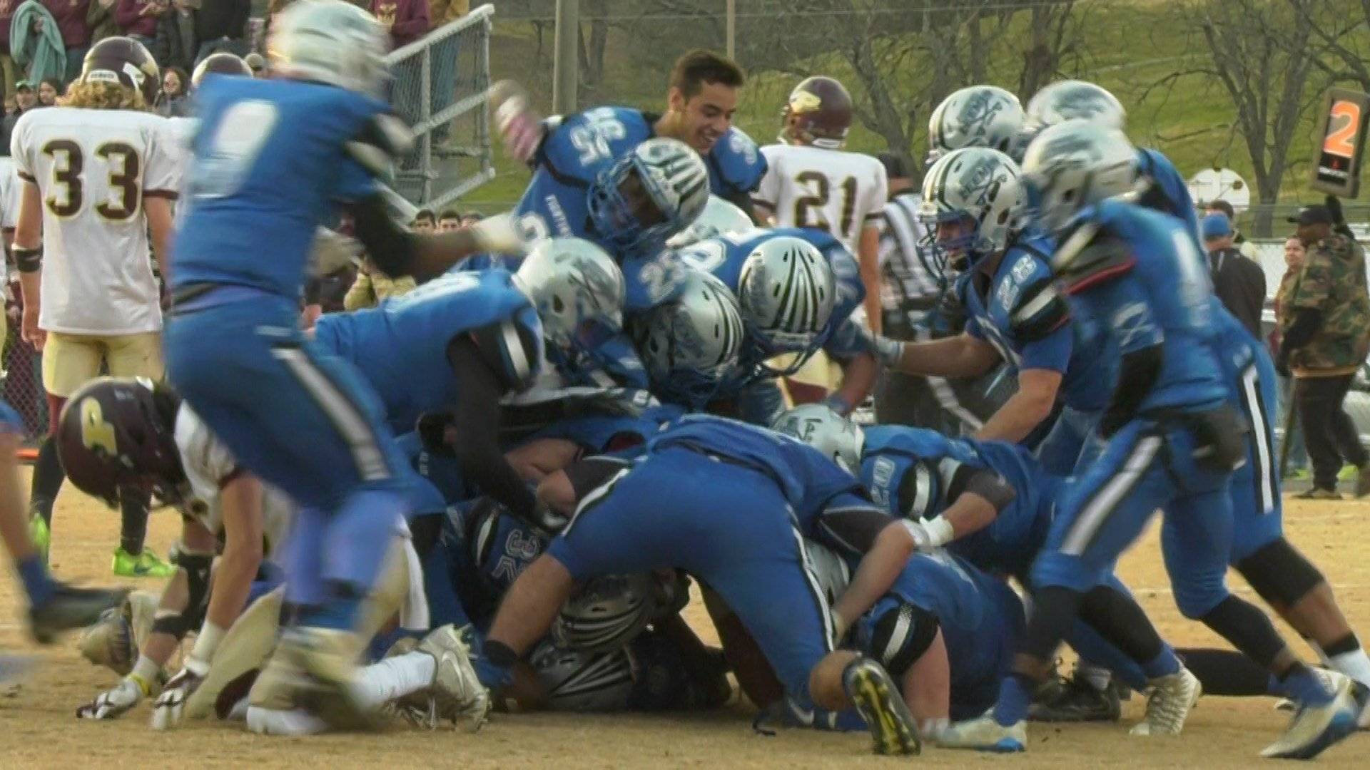 Quarterback Jayden Williams was at the bottom of a dog pile following the victory by the Leemen in the semifinals