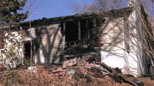 Scene of a fatal house fire along Matthew Mill Road