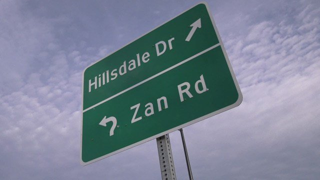 Sign at roundabout for Hillsdale Drive and Zan Road