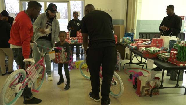 People handed out gifts at Tonsler Park on Dec. 23