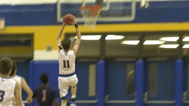 WAHS sophomore Garrett Payne goes up for a dunk