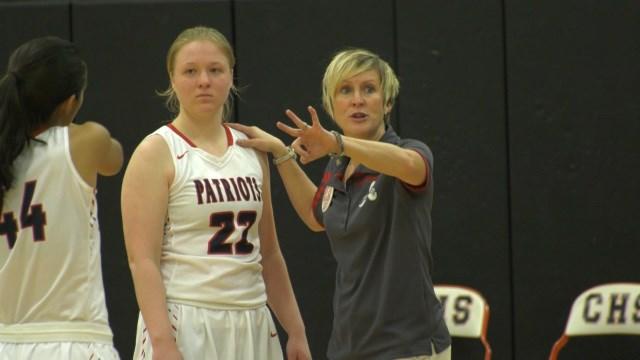 Albemarle's Quinn Graves talks with head coach Rachel Proudfoot