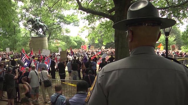 Trooper with the Virginia State Police watches over a rally by supporters and members of the Loyal White Knights of the KKK at Charlottesville's Justice Park (FILE IMAGE)