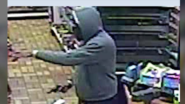 The robber held up customers and the clerk at gunpoint