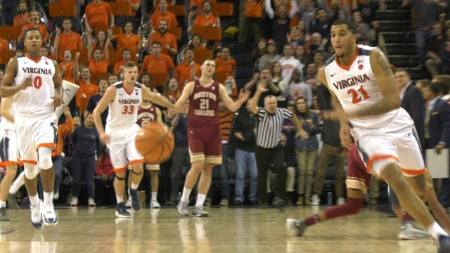Isaiah Wilkins chases down a loose ball against Boston College