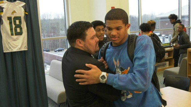 Junior linebacker Brandon Smith talks with his new head coach