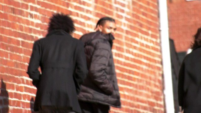 DeAndre Harris (CENTER) leaving Charlottesville General District Court