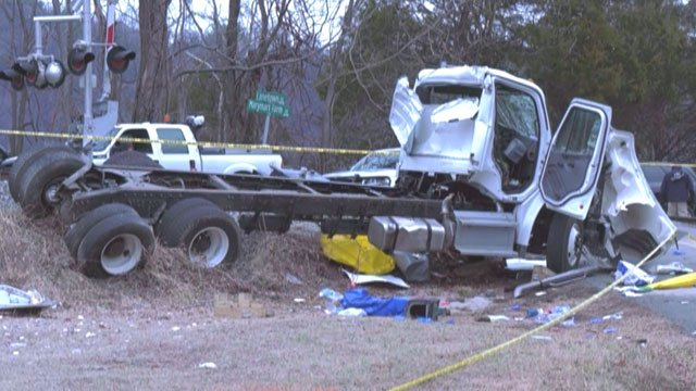 Authorities continue to investigate scene of a deadly train crash in Crozet