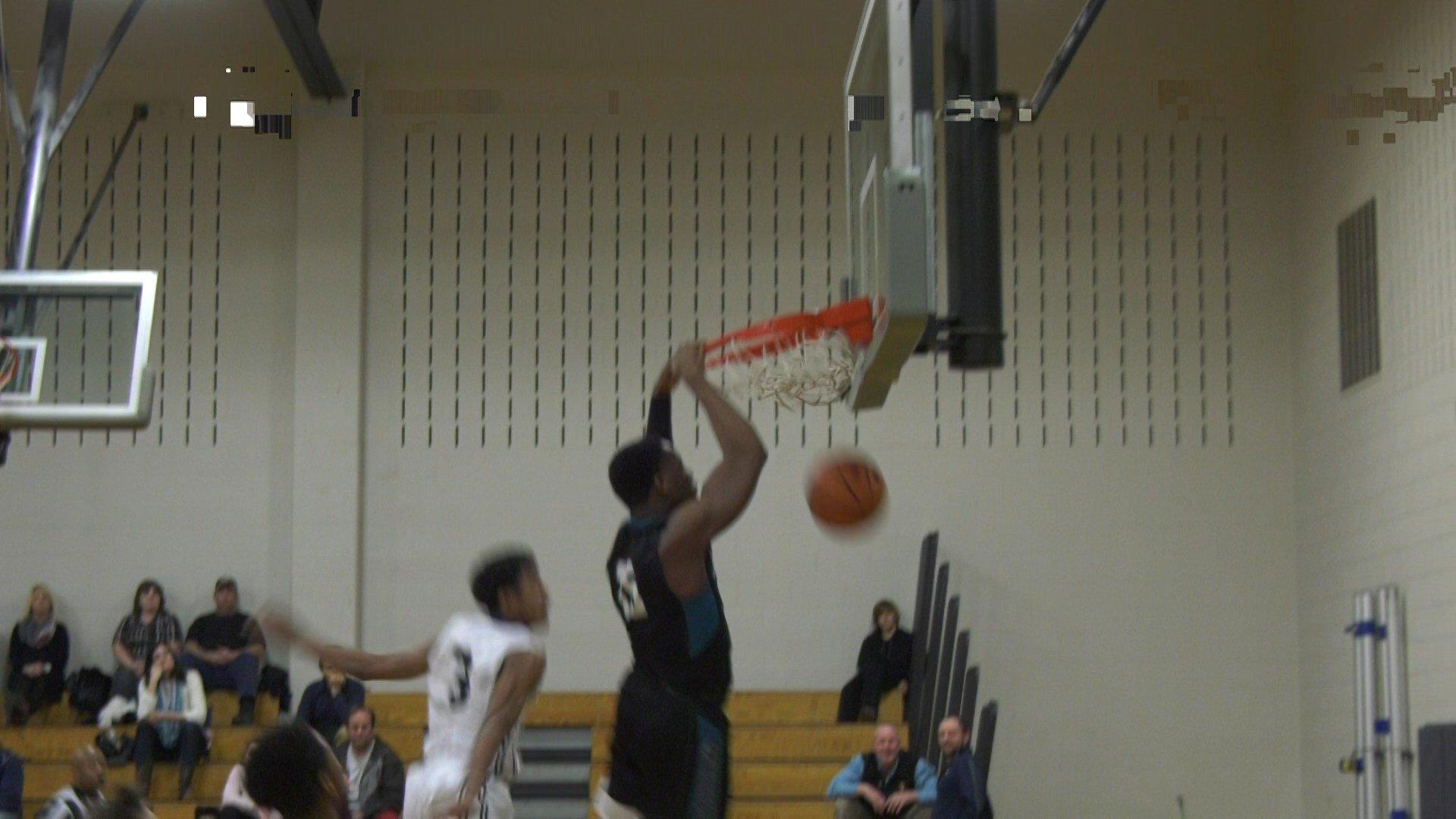 Miller's Aundre Hyatt with the dunk