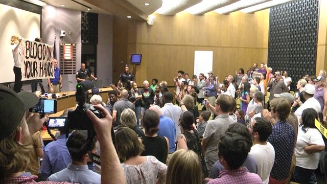 Protest erupts during City Council meeting on August 21, 2017 (FILE IMAGE)