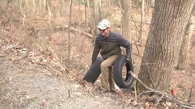 Volunteers helped pick up over 100 old tires Friday
