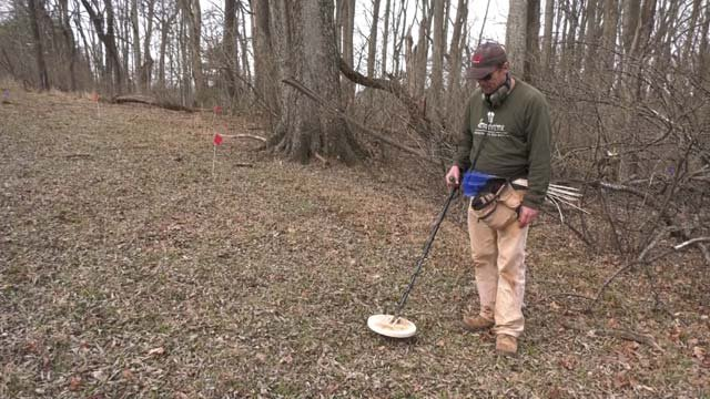 Surveyors use metal detectors to try to unearth bits of history